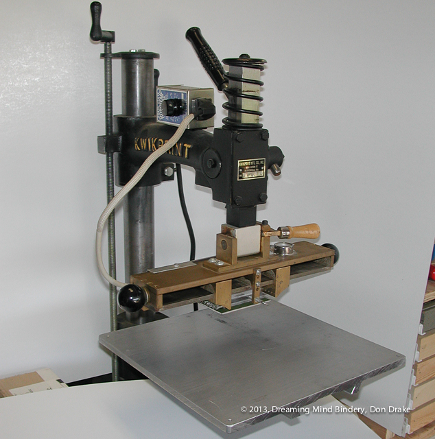 A Kwikprint 86 foil stamping machine