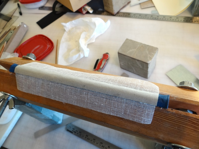 Lining the spine of the diary before putting the bonnet on.