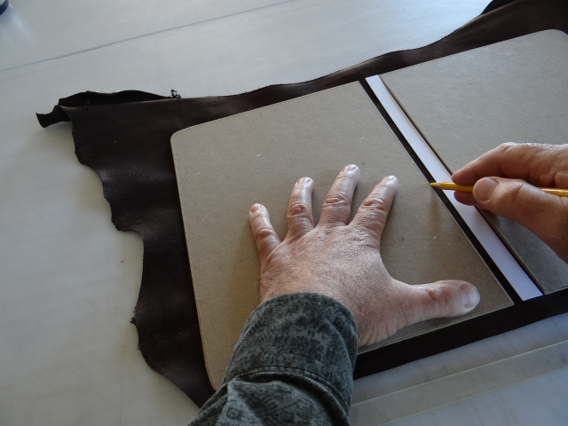 Laying out the cover inside a goat skin