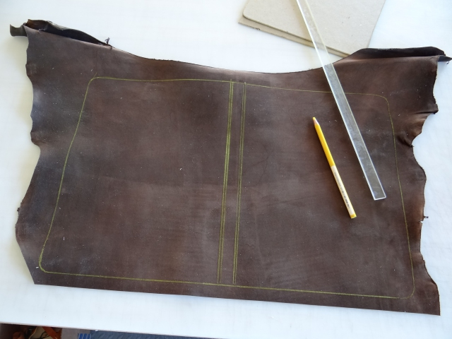 The goatskin with the layout done and ready to trim out