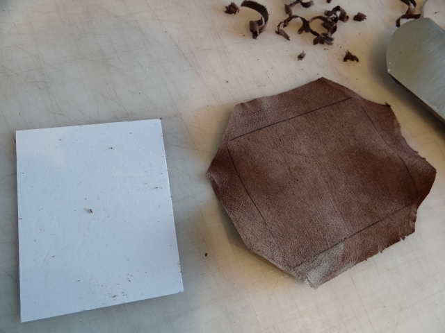 part ready to create a leather covered card pocket for the portfolio
