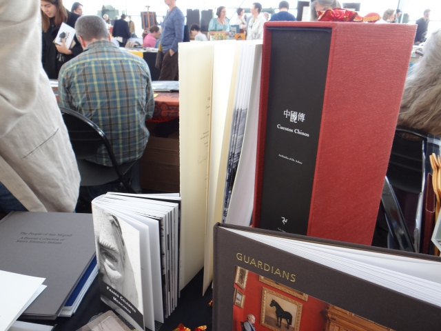 A finished copy of Luis Delgado's Cuentos Chinos displayed on his Malulu table at the 2013 Codex in the Craneway Pavillion, Richmond, CA