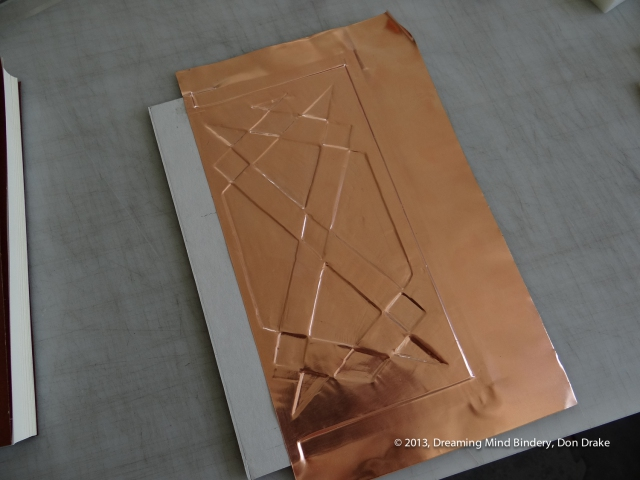 Debossing copper into a design for the back cover of a journal