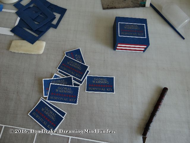 Labels ready to apply to copies of Don Drake's miniature book 'Global Warming Survival Kit'