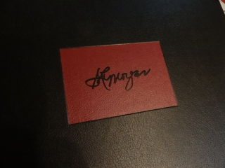 A hot stamped label with the stamping die made from an artist's signature.