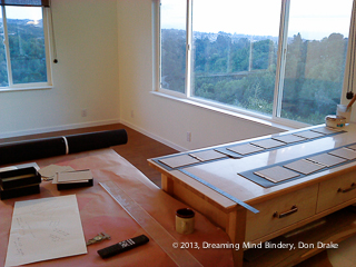 A copy of Wanderlost being bound in the newly constructed Dreaming Mind Studio prior to official move-in.