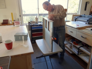 Using an adjustable height table to bring a project to a comfortable working height