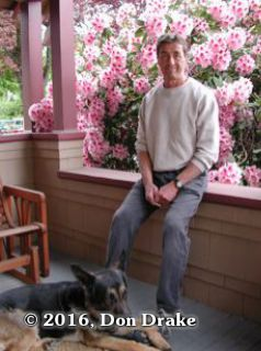 The late Hugh Stump sitting on his front porch in Oregon with a blooming rhododendron behind him